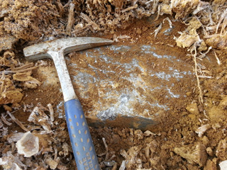 Graphite vein boulder found during build out of road to new drill hole location.